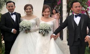 Tiến Đạt nắm váy kéo vợ đi trong hôn lễ