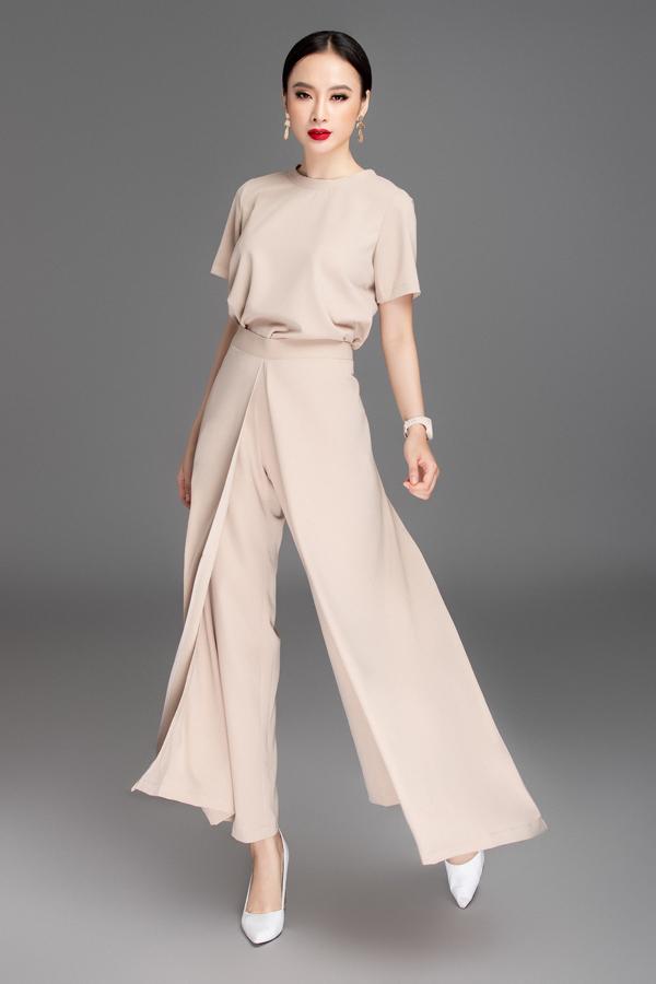 Áo lụa đơn sắc được phối hợp nhịp nhàng cùng mẫu quần biến tấu mang lại hình ảnh phá cách cho người mặc.