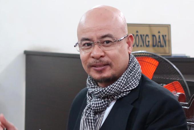 Ông Đặng Lê Nguyên Vũ trong phiên hòa giải ly hôn lần hai hôm 14/8/2018. Ảnh: Lan Ngọc.