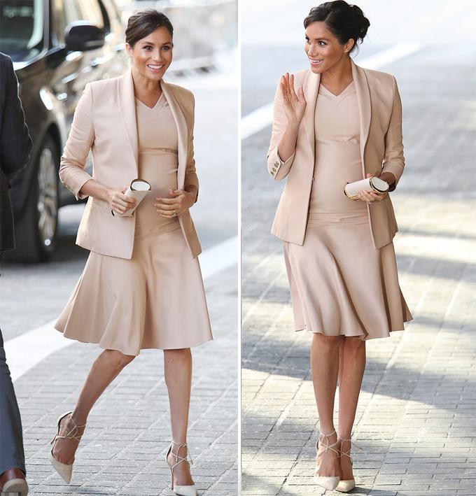 Meghan xinh đẹp trong bộ trang phục tổng trị giá hơn 5.000 USD khi tới Nhà hát Quốc gia ở London hôm 30/1. Ảnh: PA.