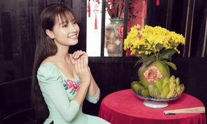 Khánh Hiền diện 5 bộ áo dài chụp ảnh Tết