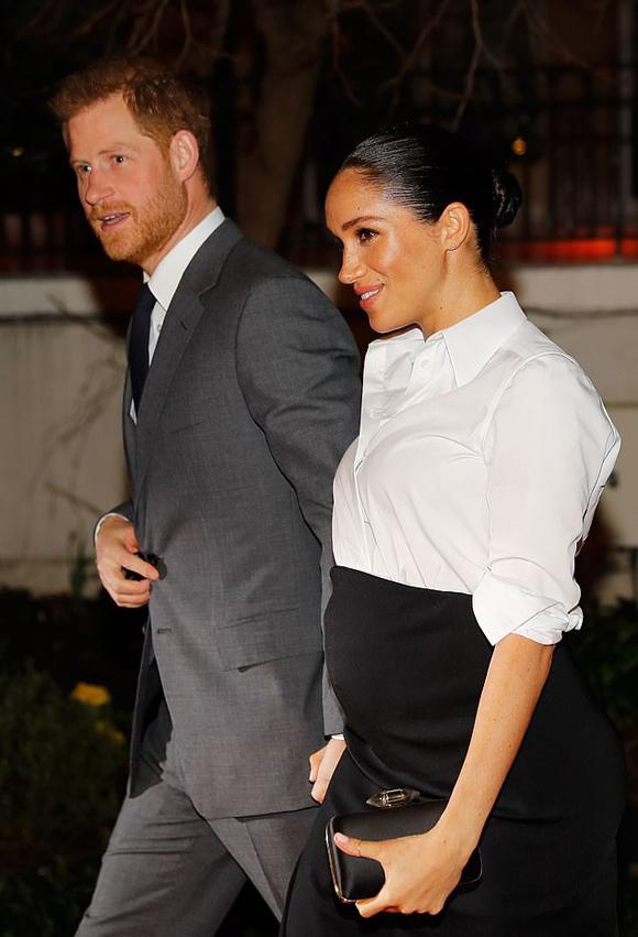 Vợ chồng Harry - Meghan dự lễ trao giải cho người khuyết tật ở London tối 7/2. Ảnh: PA.