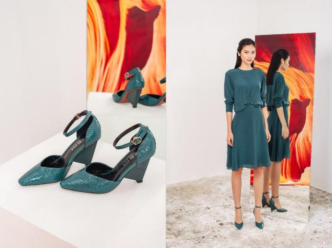 Đầm xanh cổ vịt từ chất liệu suôn mượt, cao cấp cho sắc màu đạt đúng độ tiêu chuẩn, phối cùng giày đồng tông dễ phối và tôn da.