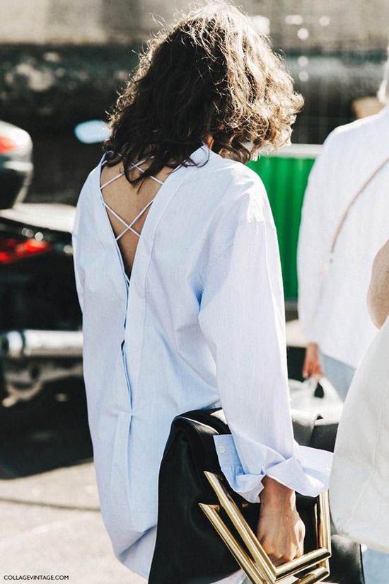 Cùng với chi tiết hàng cúc chạy dọc thân áo, nhiều thương hiệu còn mang tới các mẫu sơ mi dáng rộng trang trí dây đan bắt mắt.