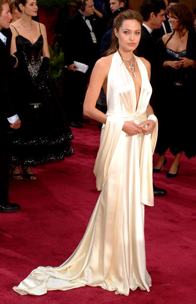 Angelina Jolie - 2004 Oscars The ice-white Marc Bouwer gown showed off all Angelina Jolies assets at the 2004 Academy Awards.