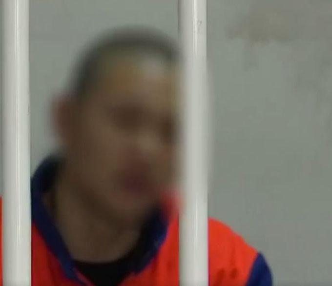 Feng đang bị bắt giam vì cáo cáo buộc bán con. Ảnh: AsiaWire.