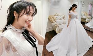 Ốc Thanh Vân thử váy chụp ảnh kỷ niệm 11 năm ngày cưới
