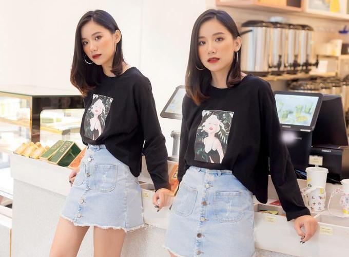 Phối cùng quần váy và tăng thêm nét năng động cho vẻ ngoài là mẫu áo thun tay dài in họa tiết cô gái, chất liệu cotton 100% 2 chiều và được bán với giá 180.000 đồng trên Store Ngôi sao.