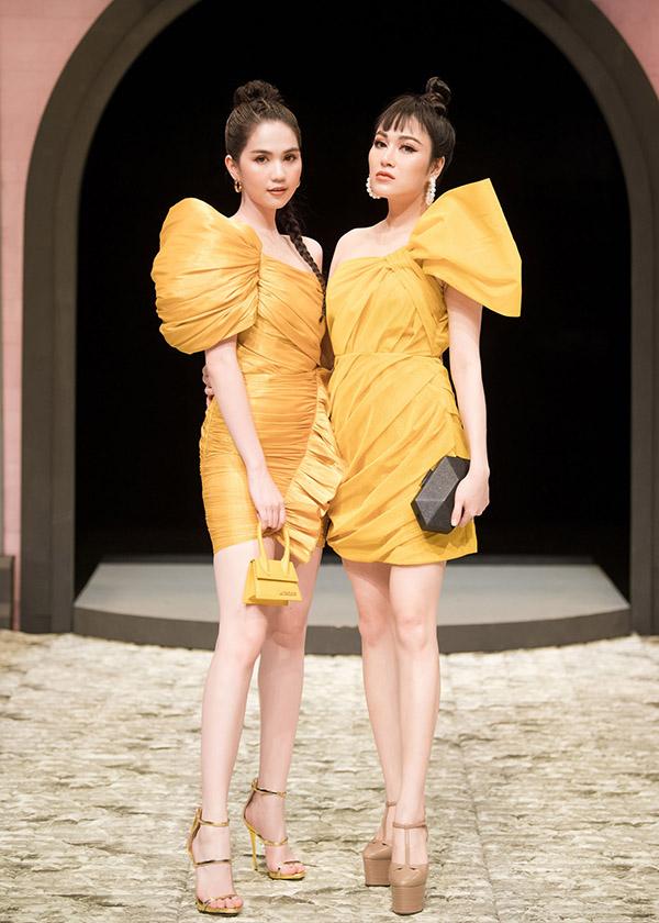 Hoa hậu Áo dài 2019 Tuyết Nga cũng mặc váy vàng lệch vai đi sự kiện. Cô có mối quan hệ thân thiết với Ngọc Trinh.