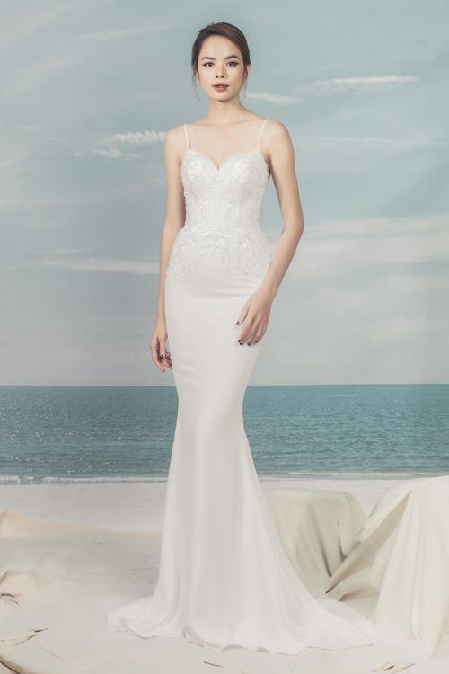 Xu hướng váy cưới hiện đại dần chuyển dịch tới các thiết kế tối giản hơn. Hình ảnhváy cưới với tùng váy lớn gây vướng víu đã dần nhường chỗ cho sự thnh lịch mà sng trọng.