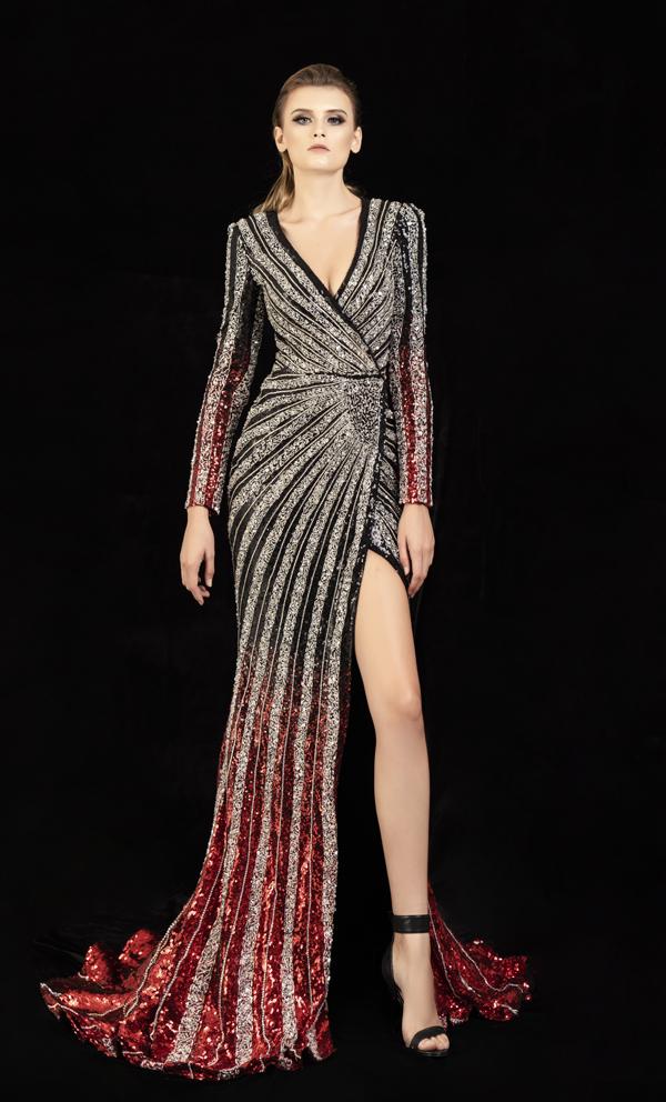 Váy đi tiệc mùa hè được tô điểm bằng họa tiết lấp lánh có khả năng bắt sáng cao. Bên cạnh đường xiết eo tinh tế là phần cut-out sắc nét để giúp người mặc khoe vẻ đẹp hình thể.
