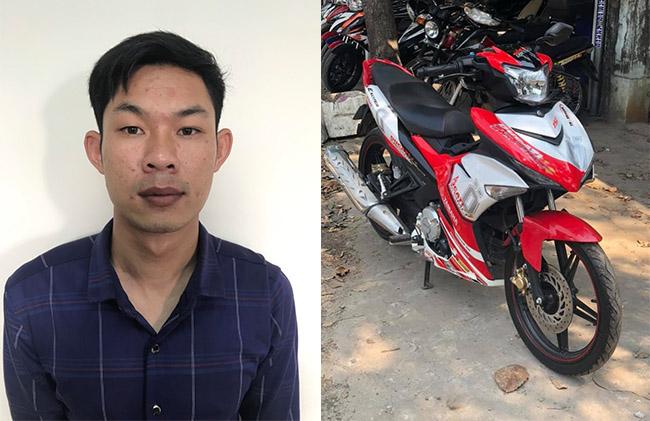 Nguyễn Văn Lực và chiếc xe máy ăn trộm. Ảnh: Đại Hiệp.