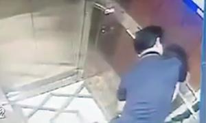 Cựu viện phó ôm hôn bé gái trong thang máy Sài Gòn