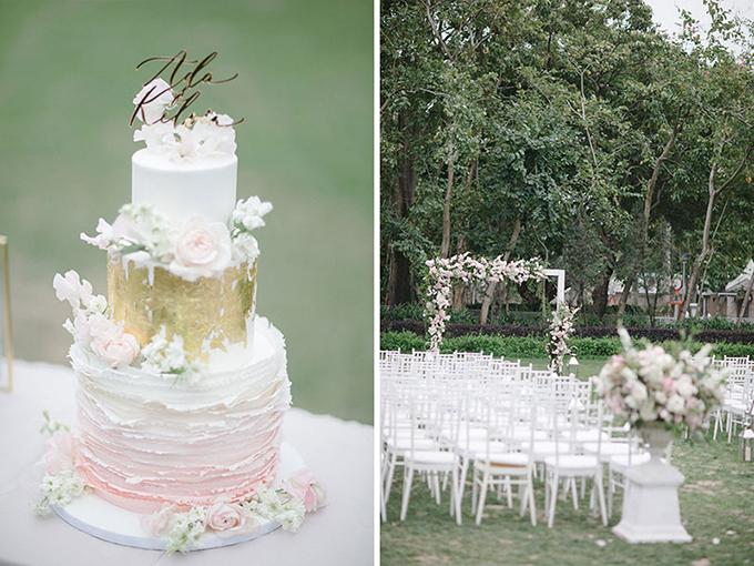 Bánh cưới mang tông màu chủ đạo trắng - hồng và có điểm nhấn là lớp vàng óng ánh ở tầng bánh thứ hai. Trên cùng là tấm bảng tên của uyên ương theo phông chữ thư pháp nghệ thuật.