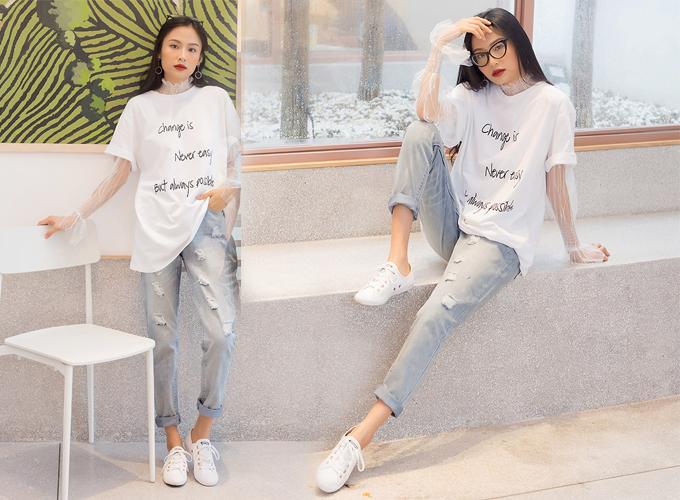 Áo thun và quần jeans là cặp đôi quen thuộc trong set đồ dạo phố của bạn gái, giúp mang lại sự khỏe khoắn, phong cách cho người mặc đồng thời giúp ăn gian tuổi hiệu quả. Sự ăn ý giữa áo thun và quần jeans đã được kiểm chứng qua nhiều kiểu phối khác nhau, bạn có thể chọn áo thun trơn, áo in chữ hay màu mè để phối cùng quần jeans ống đứng, ống loe hay skinny jeans. Nếu thích sự phóng khoáng trong trang phục, bạn có thể thả áo ngoài quần, hoặc bỏ vào trong quần khi phối cùng jeans ống rộng để set đồ trông gọn gàng hơn. Xem sản phẩm tại đây. Ảnh: KIMI