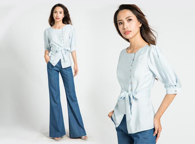 Nếu có sẵn một chiếc quần jeans ống loe, bạn gái có thể phối cùng áo tay bo kèm thắt lưng từ thương hiệuHity TOP077. Giá áo: 699.000 đồng.