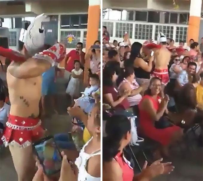 Vũ công nam chỉ mặc một chiếc khố màu đỏ để che phần nhạy cảm khi biểu diễn tại trường tiểu học bang Veracruz, Mexico hôm