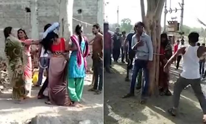 Ba người, bao gồm hai nam, một nữ bị trói ở gốc cây và bị nhóm 9 người đánh tại quận Dhar, bang Madhya Pradesh, Ấn Độ. Ảnh: SKP Live News.