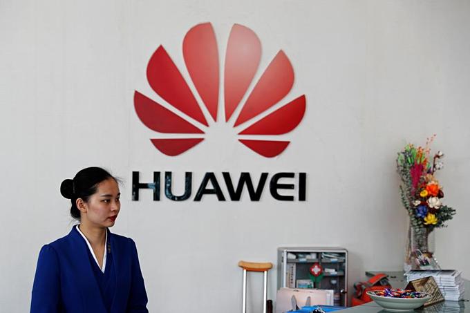Nhân viên Huawei tại trụ sở công ty ở Thâm Quyến, Trung Quốc. Ảnh:Reuters.