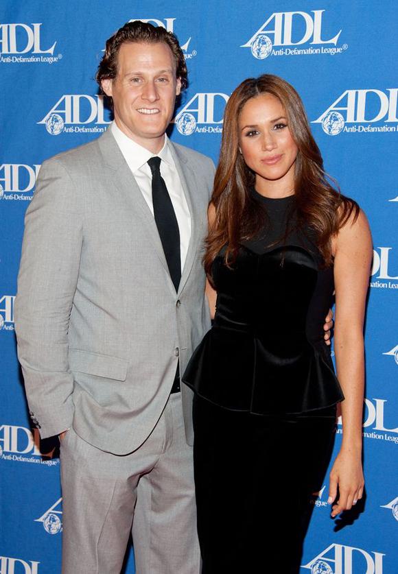 Meghan và chồng cũ Trevor Engelson khi còn mặn nồng. Ảnh: PA.