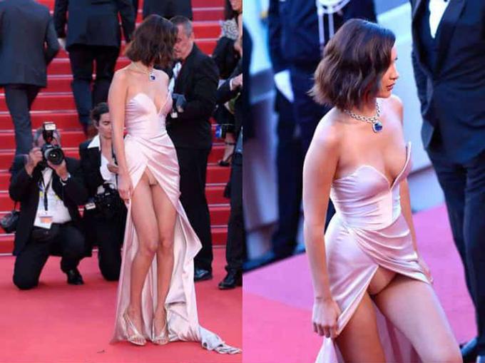 Trên thảm đỏ Cannes 2017, người mẫu Bella Hadid diện váy xẻ tới eo, liên tục lộ nội y.