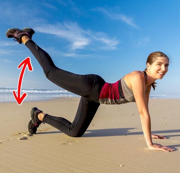 Đá cao chân Vẫn ở tư thế chuẩn bị như động tác trên, đá chân ra sau, nâng cao hết cỡ. Lặp lại động tác 20 lần mỗi bên.