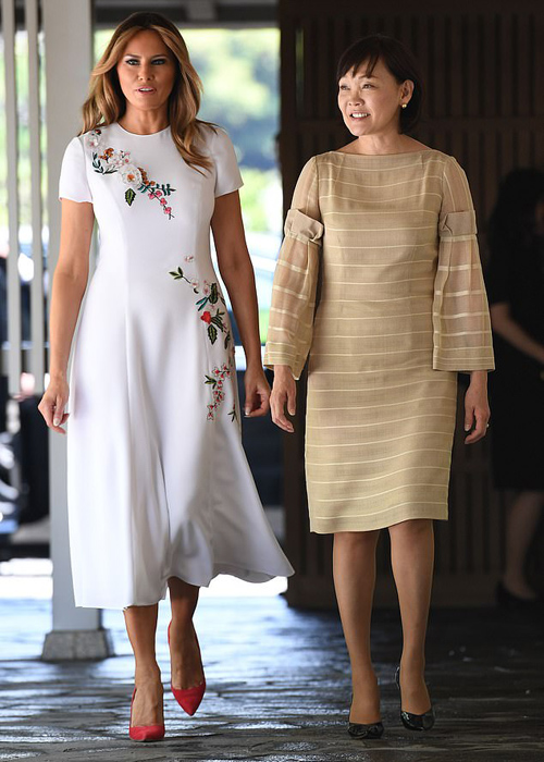 Melania, who wore $4,290 Carolina Herrera dress with floral detailing and red pumps, joined Prime Minister Abes wife Akie Abe as they walked to the Akasaka Palace Annex