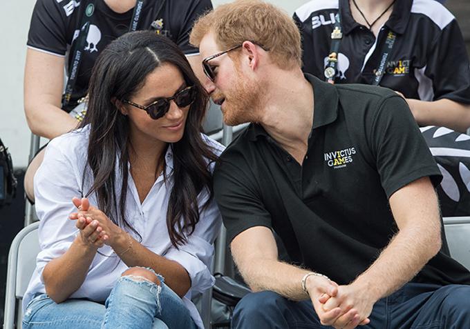 Harry và Meghan lần đầu xuất hiện công khai cùng nhau ở Thế vận hội Invictus Games năm 2016 tại Florida, Mỹ. Ảnh: PA.