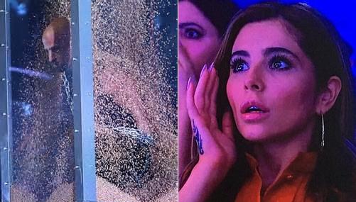 Ca sĩ Cheryl Cole ngồi dưới không thể chớp mắt vì hồi hộp.