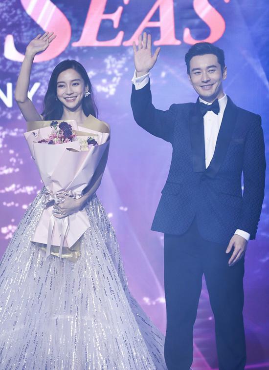 Huỳnh Hiểu Minh xách váy cho Angelababy - 1