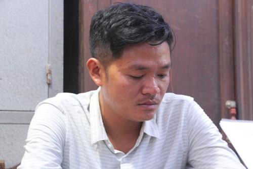 Nguyễn Hữu Tính tại cơ quan điều tra. Ảnh: Vạn An