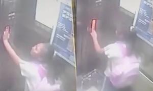 Bé 9 tuổi tự cứu mình trong thang máy trôi 18 tầng