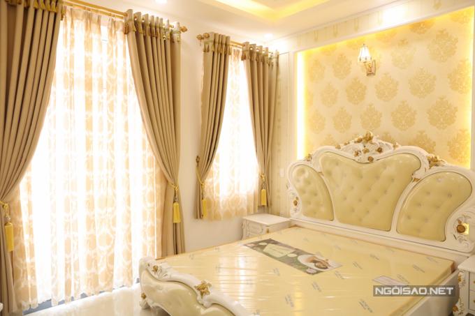 Phòng ngủ thứ hai trong nhà thiết kế gọn gàng, ấm cúng.