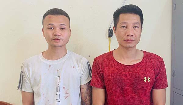 Hai nghi can Nguyễn Đoan Út (trái) và Lê Ngọc Trang tại cơ quan công an.