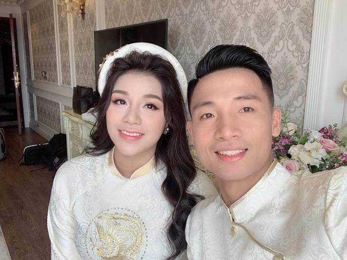 Cô dâu Khánh Linh bên chú rể Bùi Tiến Dũng.