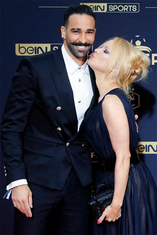Trung vệ Pháp và bom sex Pamela Anderson tại Cannes hồi tháng 5.