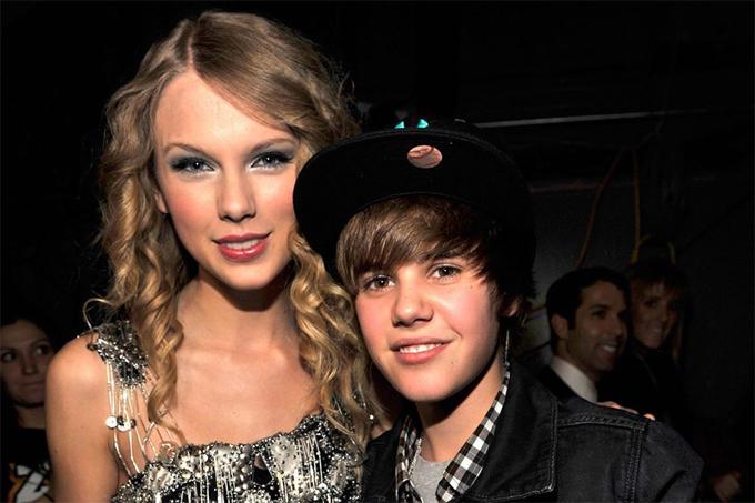 Justin đăng ảnh cũ với Taylor Swift giữa tâm bão.