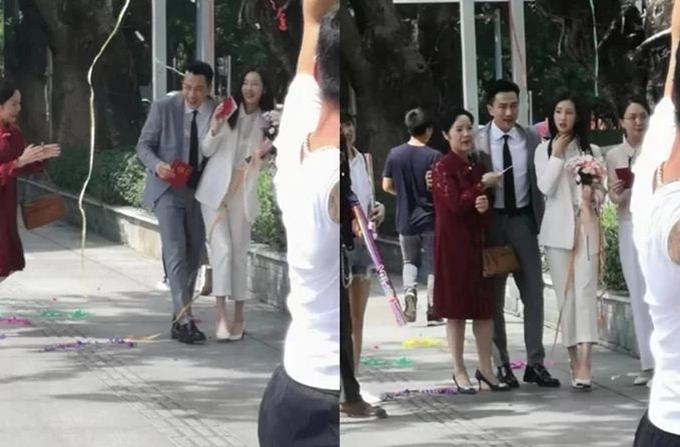 Lưu Khải Uy gây chú ý trên đường phố khi cầm giấy đăng ký kết hôn, đi bên cạnh một cô gái.