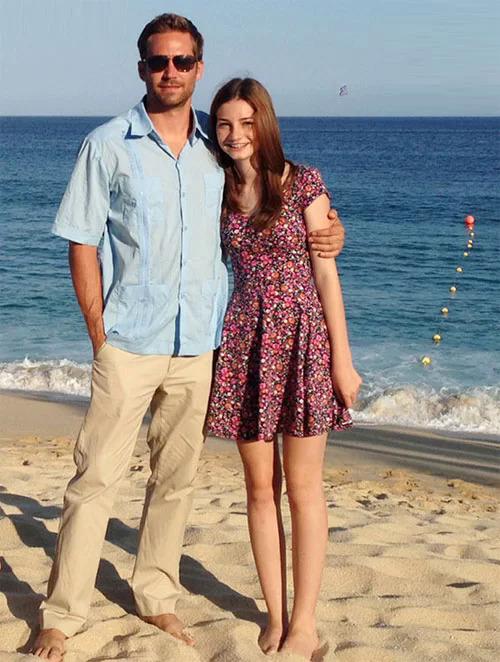 Paul và con gái năm 2012.