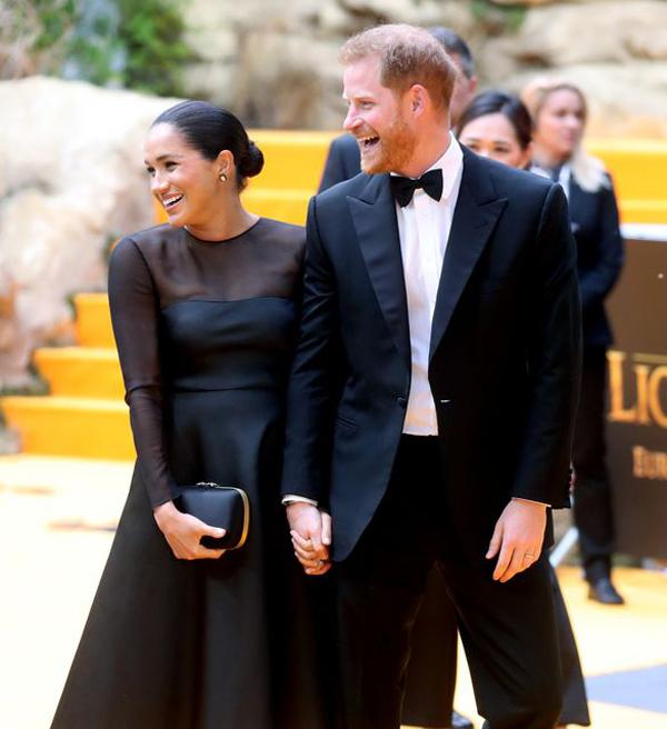 Vợ chồng Harry - Meghan đi dự công chiếu phim Vua sư tử hôm 14/7. Ảnh: PA.