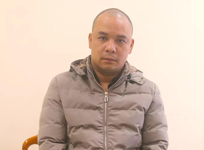 Bị cáo Quang thời điểm bị cảnh sát bắt. Ảnh: Hùng Lê