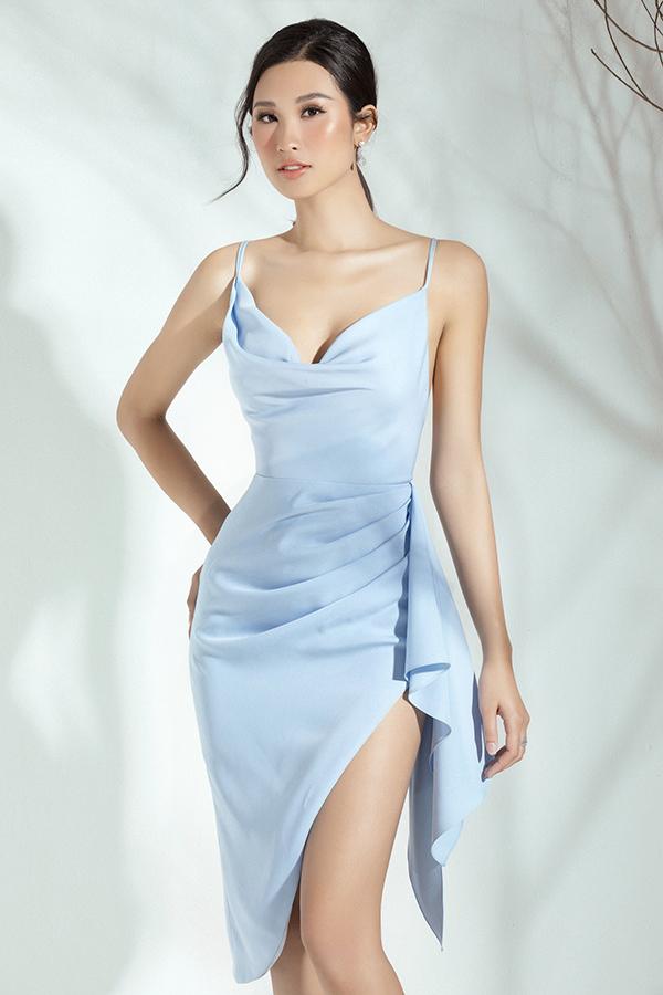 Váy hai dây xẻ cao màu bạc hà mang đến cho Phạm Anh Thư vẻ trẻ trung. Chất liệu mềm mại tôn lên đường cong quyến rũ đồng thời giúp người mặc thoải mái di chuyển.