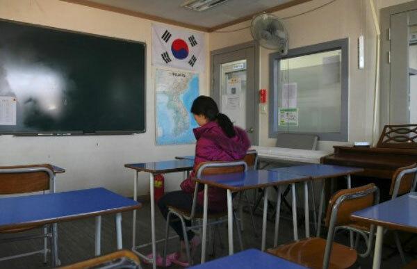 Lee Song-hee, 27 tuổi, một người Triều Tiên đào tẩu, tham gia cuộc phỏng vấn với hãng AFP tại trường Wooridul ở thành phố Seoul. Cơ sở giáo dục này dành cho những người Triều Tiên đào tẩu đã quá tuổi để theo học các trường công lập. Ảnh: AFP.