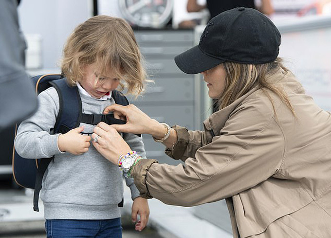 Swedens Princess Sofia helps her son, Prince Alexander, with his backpack. The young prince was watching his father compete in the Porsche Carrera Cup at the Gelleråsen Arena in Karlskoga