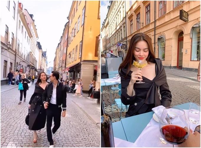 Kim Lý- Hà Hồ nắm tay nhau dạo phố và thưởng thức rượu vang.