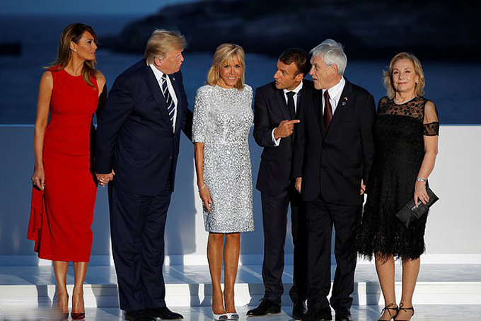 Brigitte Macron changes into her THIRD outfit of the day: Presidents wife wears pale shift dress for G7 family photo after swapping designer red gown for casual jeans earlier today
