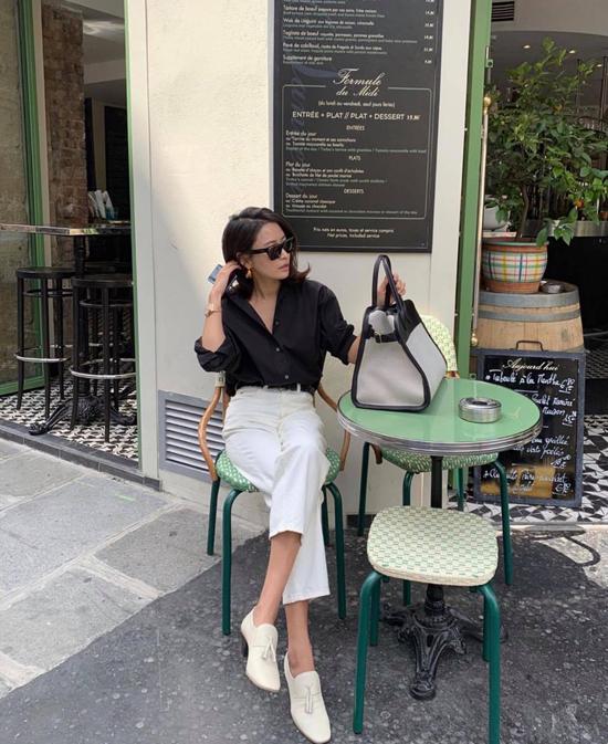 Chỉ cần một chiếc sơ mi đen có đường may chỉn chu, quần ống lửng phù hợp vóc dáng là các nàng có thể tự tin đến văn phòng hay đi dạo phố.