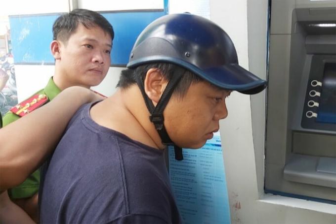 Yang Chang Cai (áo đen, đội mũ). Ảnh: Anh Thư.