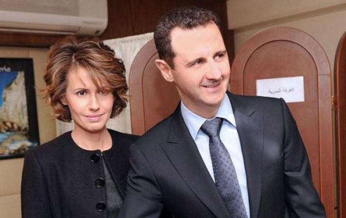 Bà Asma cạnh chồng, Tổng thống Syria Bashar al-Assad. Ảnh: Reuters.
