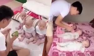 Bố trẻ vất vả trông ba con